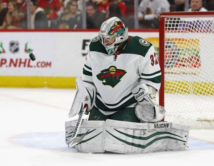 CHICAGO, IL - DECEMBER 17: Alex Stalock #32 of the Minnesota Wild keeps an eye on the puck after knocking it away against the Chicago Blackhawks at the United Center on December 17, 2017 in Chicago, Illinois. (Photo by Jonathan Daniel/Getty Images)