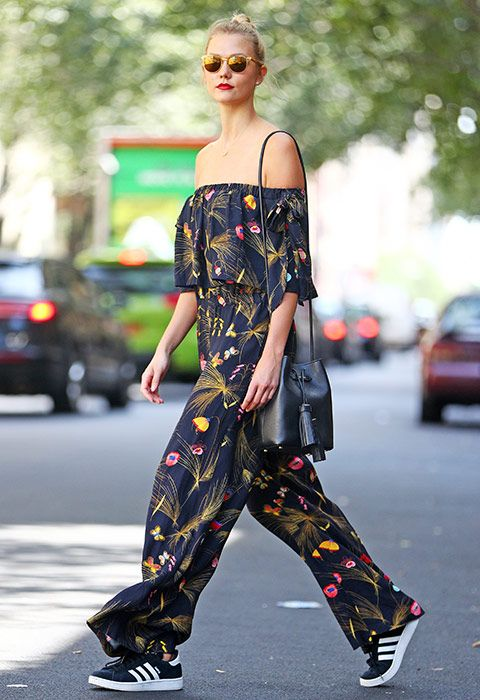 Copy Karlie Kloss and give your printed off-the-shoulder jumpsuit all the autumn feels by pairing it with a AW16-approved black bucket bag and monochrome adidas Gazelles. Finish with fall-hued mirrored sunglasses and deep red lippie