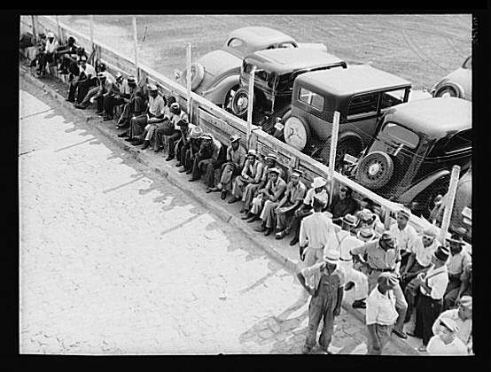 Part of the daily lineup outside the State Employment Service Office. Memphis, Tennessee. June 1938. Photographer: Dorothea Lange.