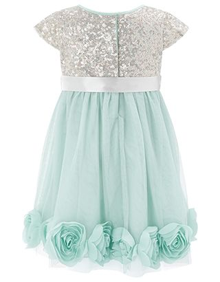 Our Kylie dress for baby girls will steal the show with sparkle. Its glitzy sequin bodice is veiled in net for a soft touch, and its layered skirt is decorat...