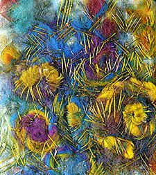 Spirals of felt tops couched down with freely placed randomly dyed silks. By Jean Littlejohn