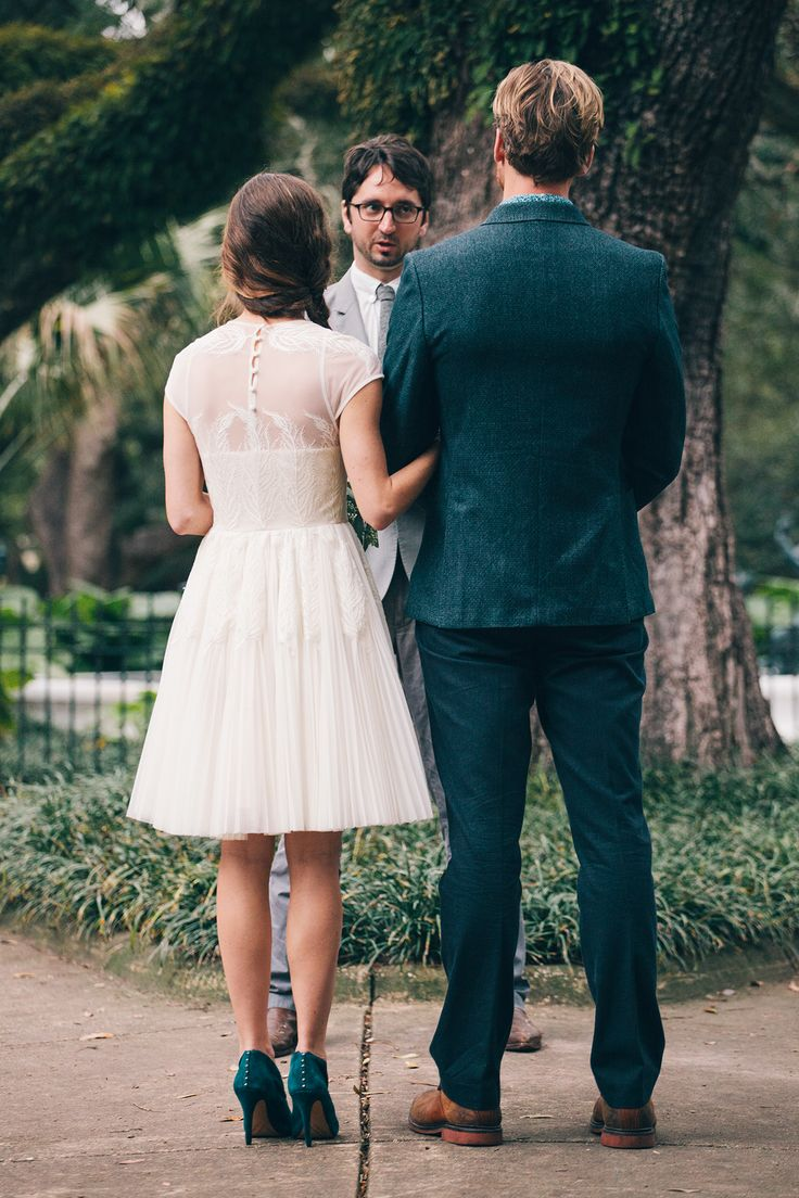 Short Ted Baker dress and teal booties - love this bride's unique look!