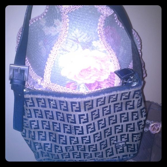 Fendi purse Fendi purse.  100% authentic. grey and navy. worn inside can take more pictures just ask :) FENDI Bags