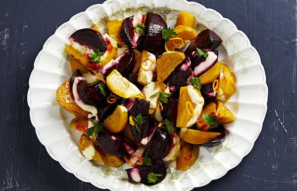 A cool and tangy crème fraîche dressing adorns a colorful combination of roasted red and gold beets for a simple, vibrant side dish.