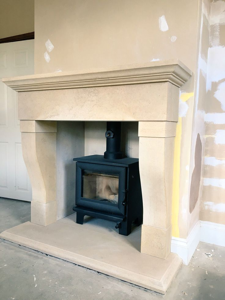 Wood burning stove and Yorkshire stone fireplace. We designed and installed this stone fireplace for our customer in Huddersfield.  We offer an installation service throughout Yorkshire.