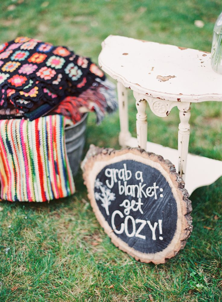 Cozy is important! See the wedding on SMP: http://www.StyleMePretty.com/2014/03/06/fall-wedding-at-cherry-basket-farm/ Photography: Michelle March