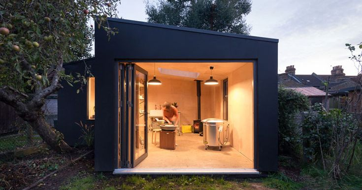 A Modern Pottery Shed Has Been Added To This British Backyard