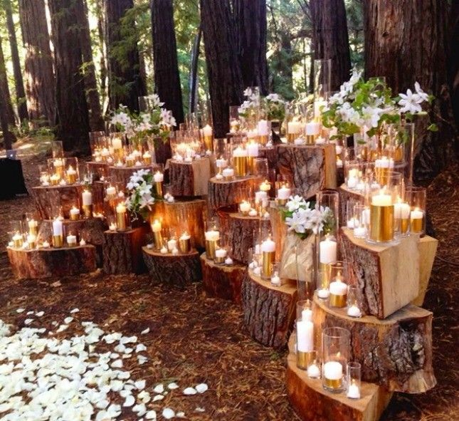 This wood stump wedding ceremony backdrop is stunning.