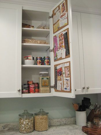 Cork board inside kitchen cabinet.