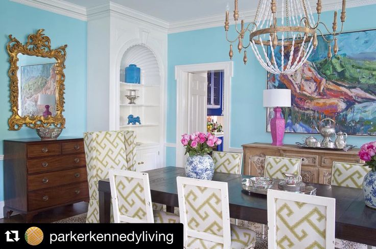 alexandra nine light chandelier elegantly hung over this colorful dining room