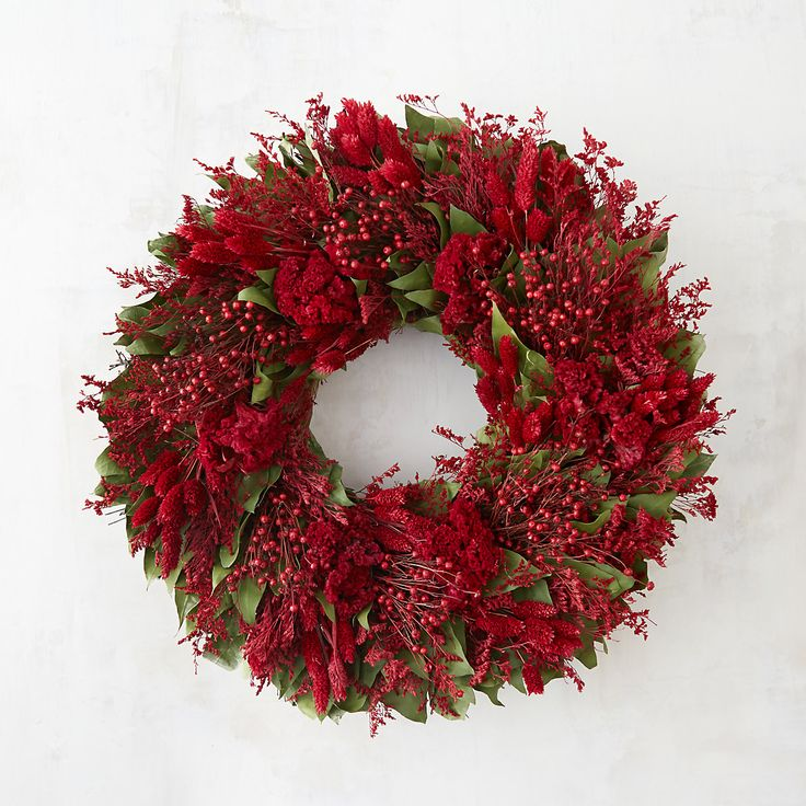 Nothing makes a warmer welcome than a wreath on the front door. Crimson & Greens Wreath