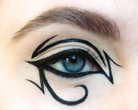Egyptian eyeliner with full around the eye. Would look cool with a base color