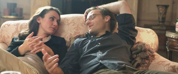 COUPLE COUCH TALKING