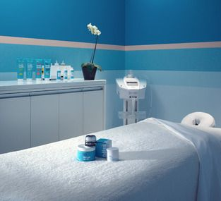 bliss spa treatment room--great use of color with white as the neutral