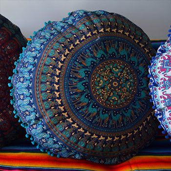 These extra large cushion covers are handmade from mandala tapestries. Available with a fringe or pom-poms. Double-sided. Approximately 34 inches in diameter. Because they are handmade, size may vary