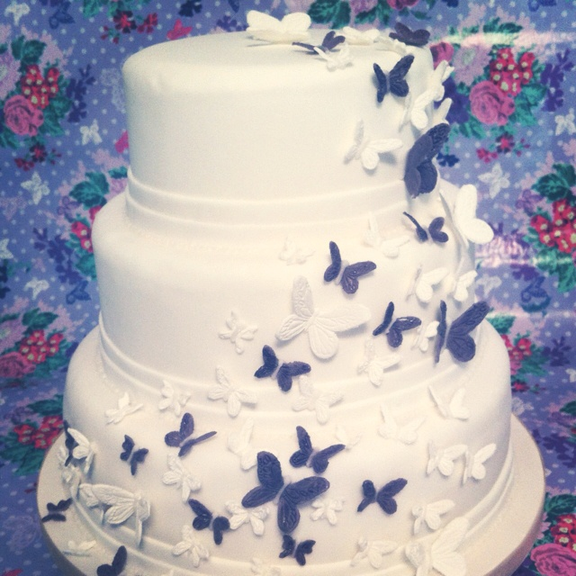 Grape violet butterfly wedding cake from £150
