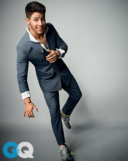 Nick Jonas. Suit by Giorgio Armani. Track jacket by EA7 Emporio Armani. Sneakers by New Balance.