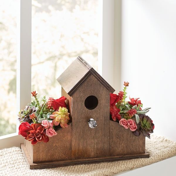 A birdhouse planter with succulents and flowers makes the perfect window display or you can give it as a gift. Get detailed instructions on how to build this beauty!