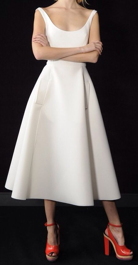 Neck upward with rolling cowl ala 1950's. Slight sleeve but that skirt! THAT SKIRT!!!