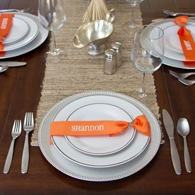A sweet little addition to your holiday (or any day) table setting. Try these easy name place ribbons instead of cards.