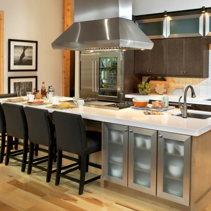 A cooktop, sink, storage, AND seating all in one! This island has it all!