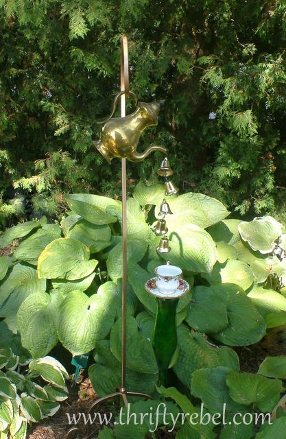 Add a little whimsy to any garden with a charming vignette using a vintage coffee pot and bells as a wind chime. Add a teacup and saucer to a bit of fun.