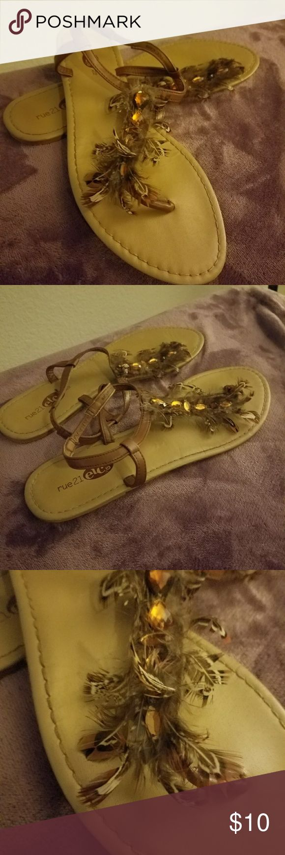 Bling and Feathered T-Strap Sandals Rue21 etc! brown t-strap sandals with brown faceted bling and feathers that have mild use, as seen from pictures. I have been storing them in a plastic shoe box to protect tbe feathers. Rue21 Shoes Sandals