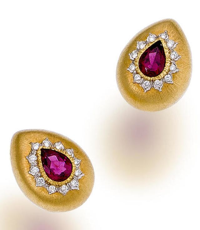 A pair of ruby and diamond earclips, Buccellati  each set with pear-shaped rubies surrounded by round brilliant-cut diamonds; each signed Buccellati