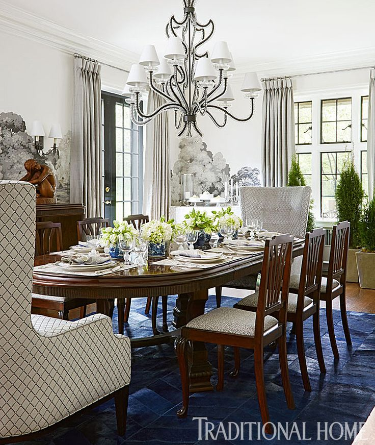 Informed by the scheme of the blue-and-white ceramics on the table, a royal blue hair-on-hide rug from Argentina adds a modern dose of saturated color to the traditional mahogany dining table and chairs. - Photo: Werner Straube / Design: Soledad Zitzewitz