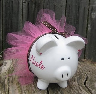 Piggy bank with tutu. My favourite piggy bank: http://www.helpmetosave.com/2012/02/piggy-bank/