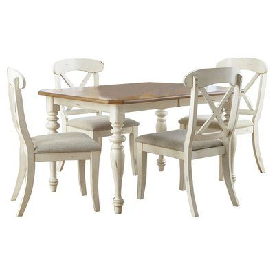 Lend an air of charm to your dining décor with this beautiful dining set. The dining table showcases a Cherry finished table top resting upon a white finish pedestal, lending a lovely contrast in color. An leaf expands the table surface to offer additional dining space when needed. The dining chairs are built with lustrous Cherry finish contoured seats resting upon white wooden frames, with vertical slatted backs and turned front legs. Finished in White for a neat appeal.