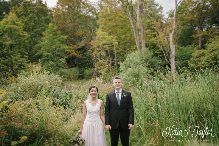 Artistic shot of bride and groom surrounded by forest. James Gardens, Toronto wedding photography.