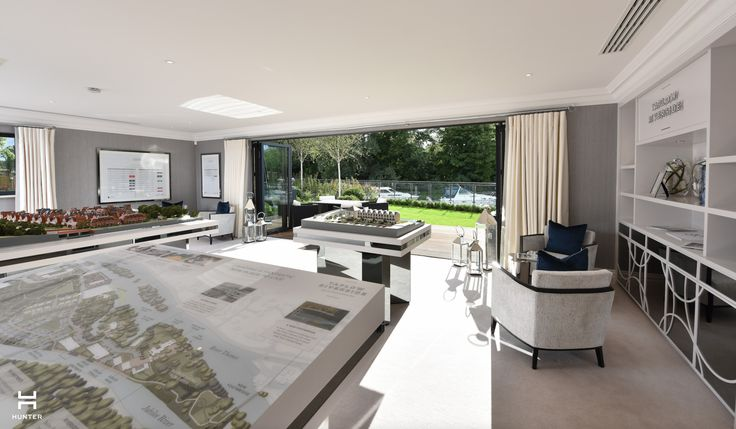 Taplow Riverside Marketing Suite www.hunter-design.co.uk  Development models mixed with beautiful upholsted chairs and views out to the river. Bespoke joinery with fretcut detail and mirror front.  Curtains and soft furnishings designed by Hunter and handmade by Thompson & Oliver.