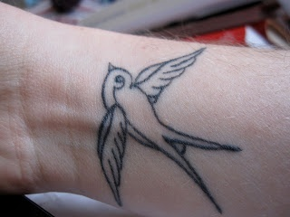 Goldfinch tattoo.