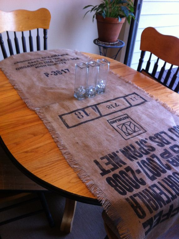 Reclaimed burlap coffee bean bag table by InteriorLandscapes can be used as a runner or a window valance.