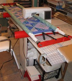 Simple DIY machine quilting frame. I don't know how on earth I would do this but it looks awesome.