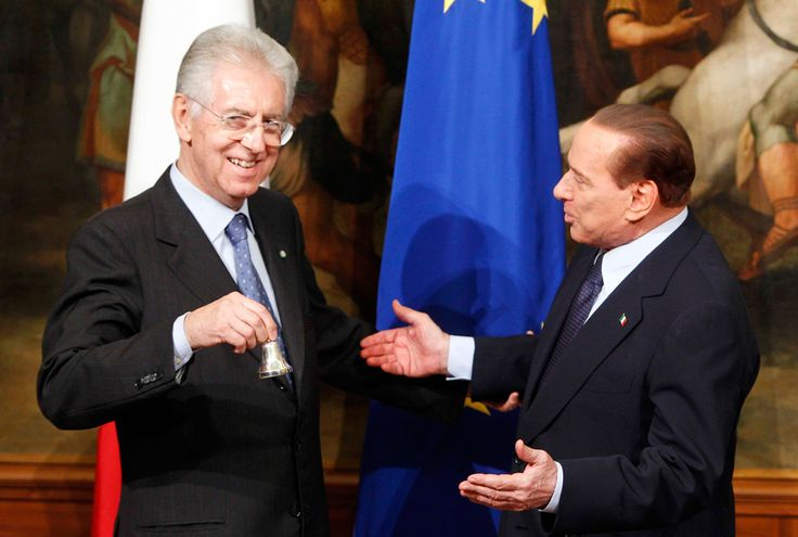 Dalla padella alla brace.    Italian premier Mario Monti receives a small bell from former premier Silvio Berlusconi at Chigi palace premier's office after the swearing in ceremony, in Rome. The bell is used by the Prime Minister to call attention during cabinet meetings, Nov. 16, 2011. Berlusconi resigned after numerous scandals were exposed, weaking his ruling power. (Pier Paolo Cito/Associated Press)