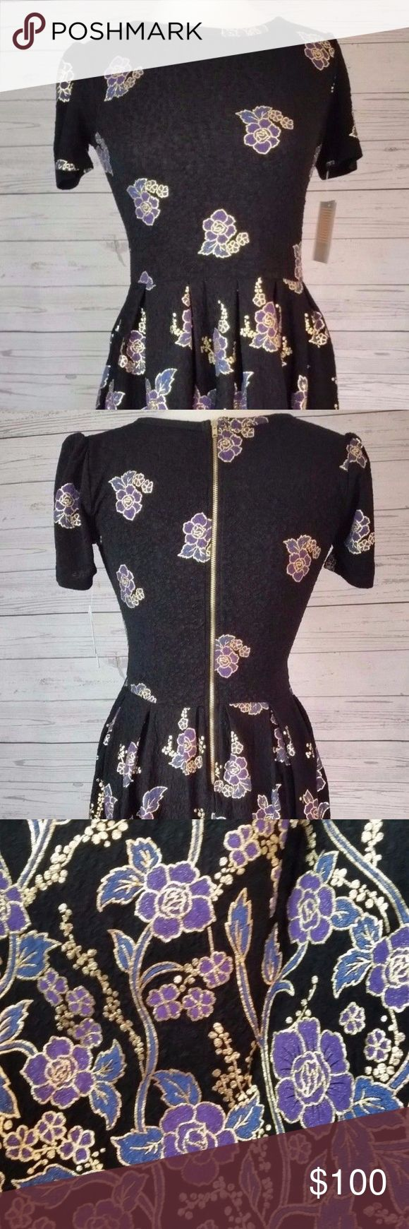LuLaRoe Elegant Collection Amelia This is the newly released 2017 Elegant Collection Amelia.  This is absolutely stunning in person! This beauty will carry over and can be worn for Valentine's Day, Easter, upcoming weddings, etc.! I am not a LulaRoe Consultant. I do not get my clothing items at cost. Size: XL  Print/Color: Black background, with subtle cheetah-like design. Purple, blue, gold floral design. New with tags. LuLaRoe Dresses
