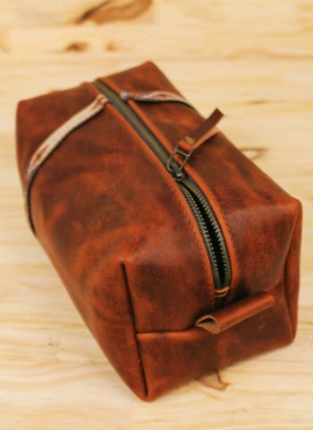 A Dopp kit, in its original definition, meant a leather bag that held a man's grooming kit while traveling. #grooming #travel #menstyle
