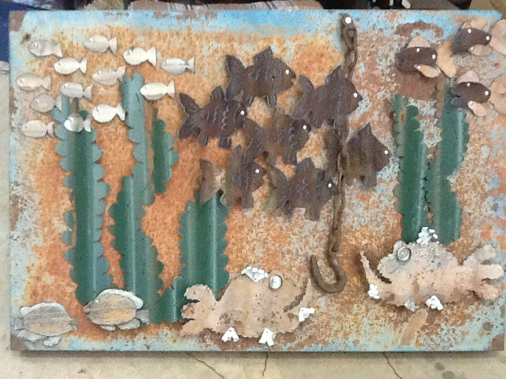Metal ocean scene 900mm x 900mm. Made from old fencing materials and an old sling chain and hook.