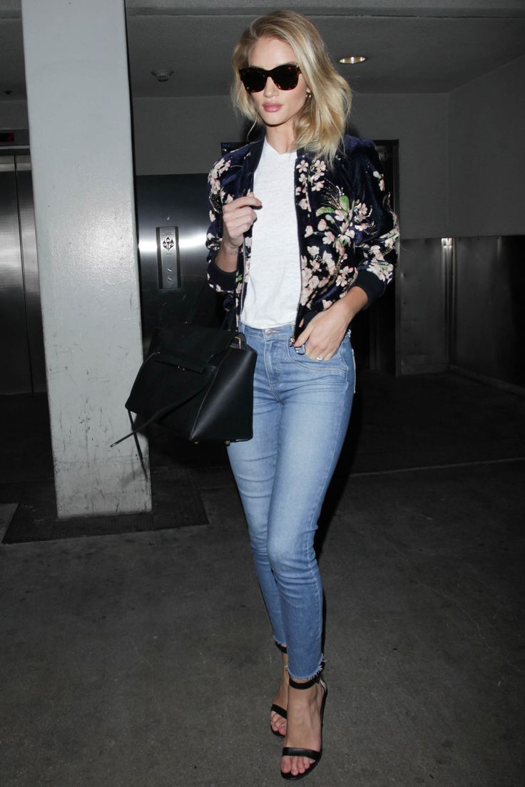 8 June 2016 - Rosie Huntington-Whiteley was seen making her way back into Los Angeles wearing a floral bomber jacket and jeans.   - HarpersBAZAAR.co.uk
