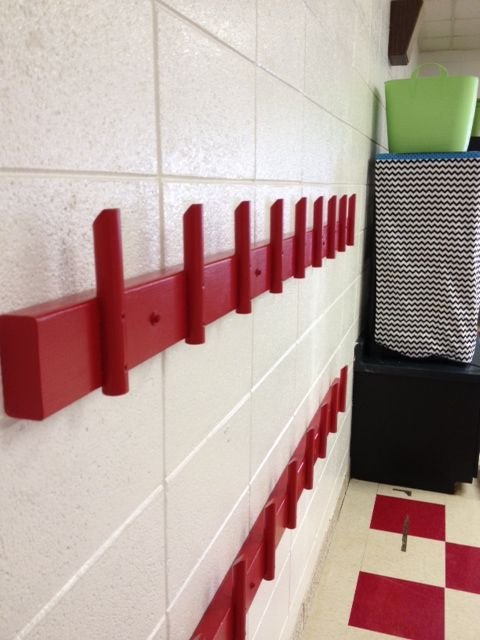 A safer style of backpack hook rack - no more protruding metal hooks to bump into or pegs that let things slide off as students pass, all wood