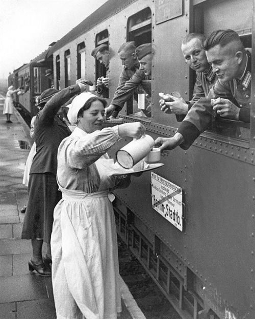 Ladies of the German Red Cross provide food and drinks to soldiers, before they head off to the front. #german #germany #deutschland #soldat #soldier #army #military #nurse #uniform #train #travel #railroad #oldschool #historical #photo #blackandwhite #history #ww2 #tea #coffee #food #redcross #schwerster