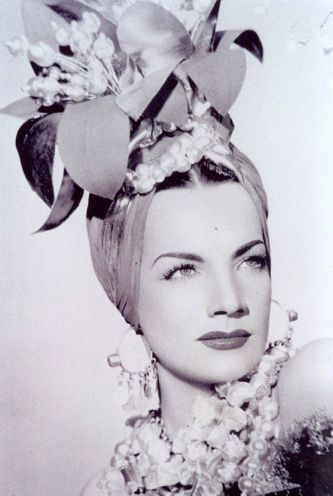 """Carmem Miranda was a Brazilian samba singer, dancer, Broadway actress, and film star who was popular in the 1940's. After establishing a successful singing and acting career in Brazil she later moved to Hollywood to pursue a film career. Nicknamed """"The Brazilian Bombshell"""", Miranda is noted for her signature fruit hat outfit she wore in the 1943 movie The Gang's All Here. By 1945, she was the highest paid woman in the United States.  Miranda made a total of 14 Hollywood films between…"""