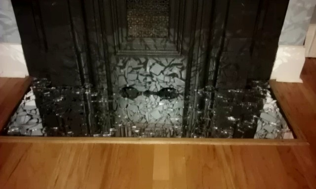 broken mirror mosaic floor... yep 7 years bad luck I smashed a mirror glued to foam board and sealed and set in front of fireplace.  Me love!