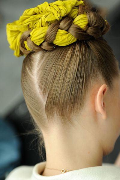 Models' hair was braided around thick pieces of fabric, creating makeshift headpieces.