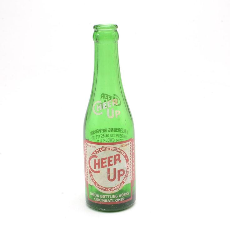 """A vintage Cheer Up soda bottle. The green bottle has a red and white label on the front that reads """"Cheer Up A Delightful Drink A Real Super-Charged Beverage Different Healthful"""" and """"Union Bottling Works Cincinnati, Ohio"""". The back of the bottle reads """"A Pleasing Beverage There is no Substitute For Cheer Up Beverage and Mixer Lithiated Lemon Soda Contains Carbonated Water, Sugar, Flavor, Citric Acid, Salt, Lithia and Soda Citrates For Hospital, Home and General Use Contenets 7 Fl. Ozs""""."""