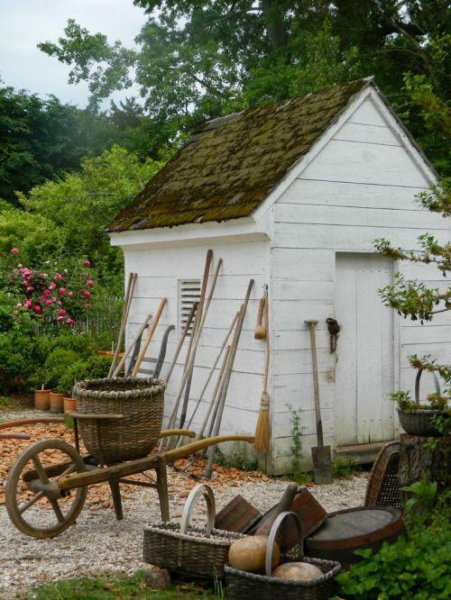 garden shed basket wheelbarrow tools
