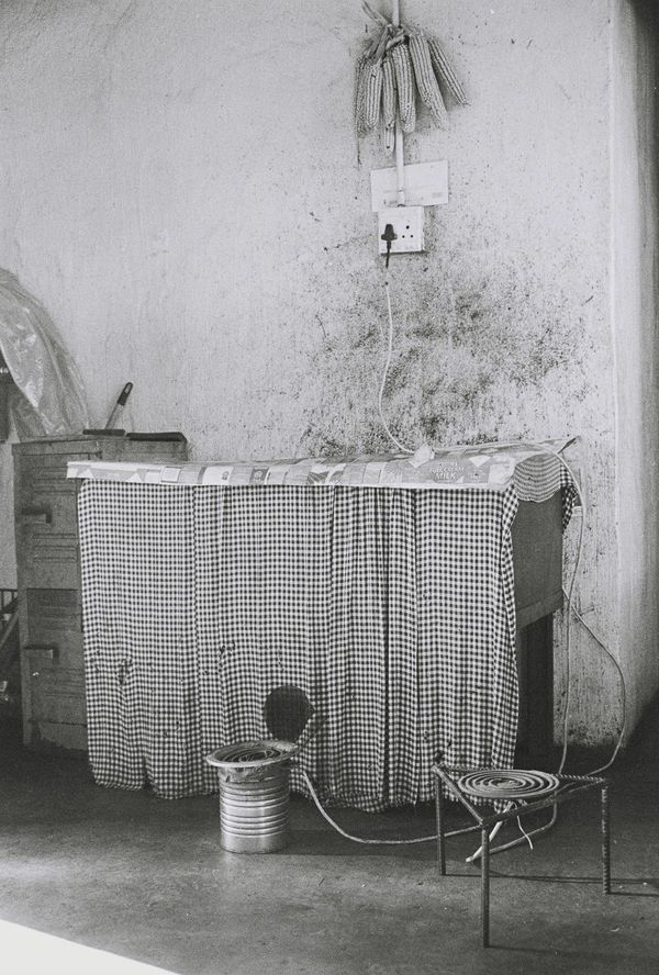 Andrew Tshabangu, Mielies, Stove and Heater, from the series Hostel Interiors, 2011 Courtesy the artist and Gallery MOMO