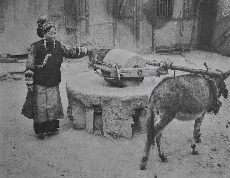 Mangghuer Woman Grinding Grain ©Zhuang Xueben